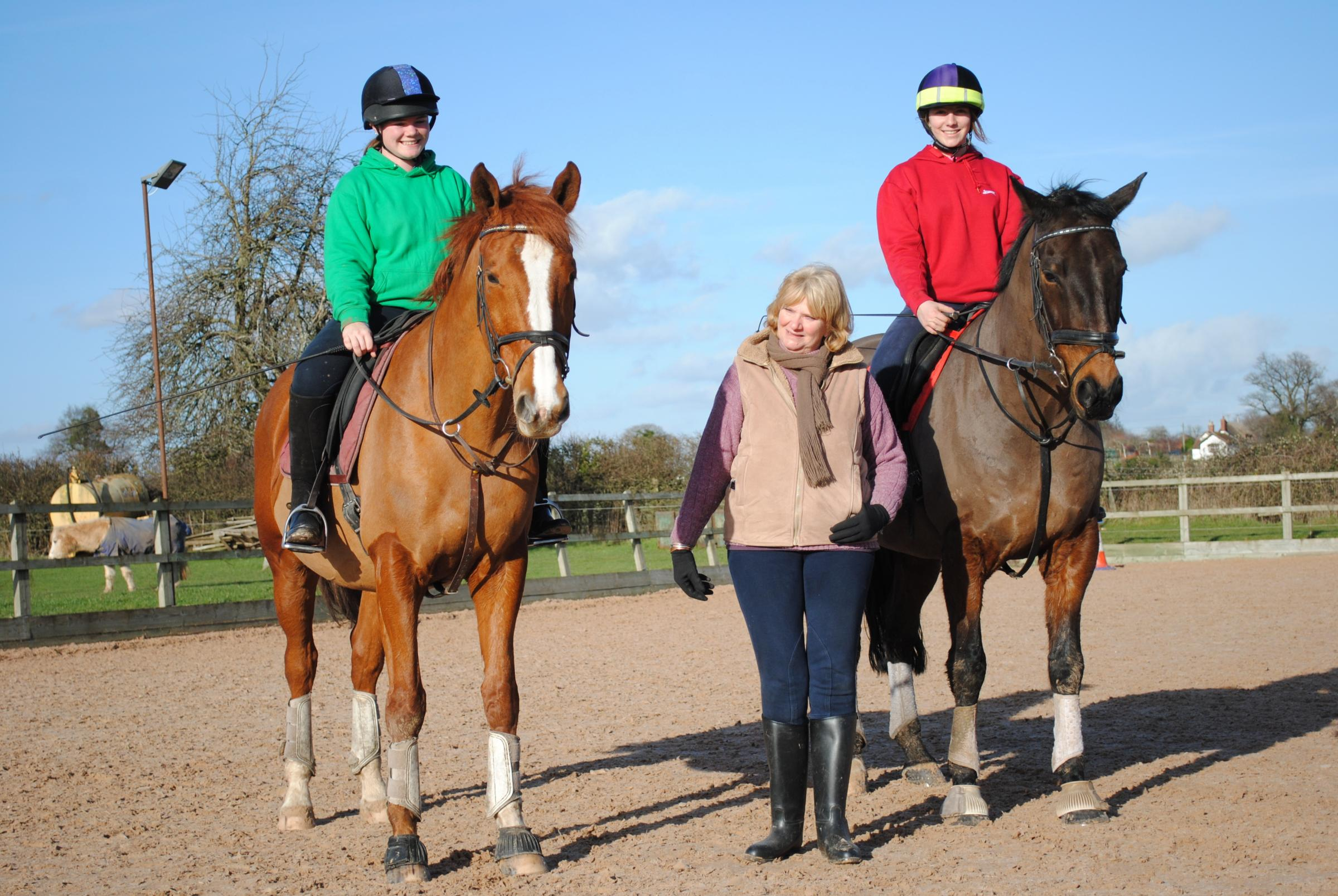 Walnut Equestrian Centre owner Jane Jones (centre) with students Annabelle Marshall and Chloe Sharman.