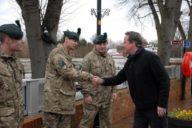 0814523207 Paul Jackson 17.02.14 Upton-upon-Severn Prime Minister David Cameron visits Upton. Meeting troops, from left -  lance cooporal Pearse Murphy, colour sargeant Neil Horner and major Darren McCleery. (4040467)