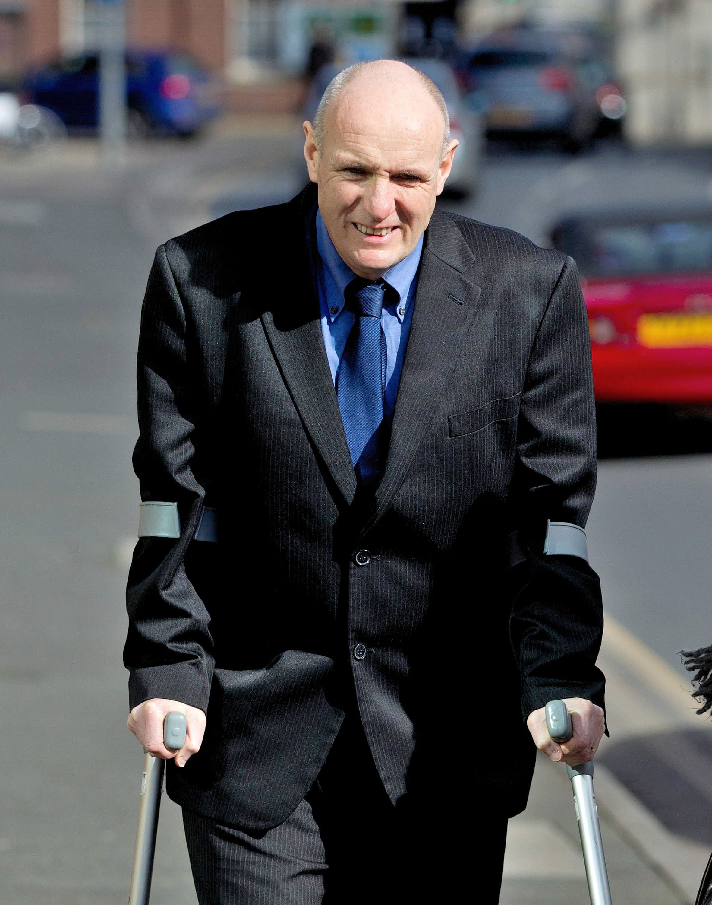 Former headteacher David Doubtfire who is charged with voyeurism, walks away from Worcester Magistrates Court.