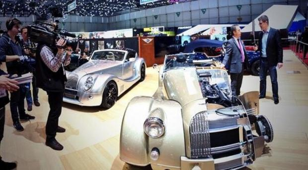 Malvern Gazette: STAR: Admirers on the Morgan stand at the Geneva Motor Show. Picture: Morgan Motor