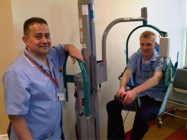 Malvern Gazette: Sam Aldridge from Worcestershire Health and Care NHS Trust being hoisted by colleague Simon Bates