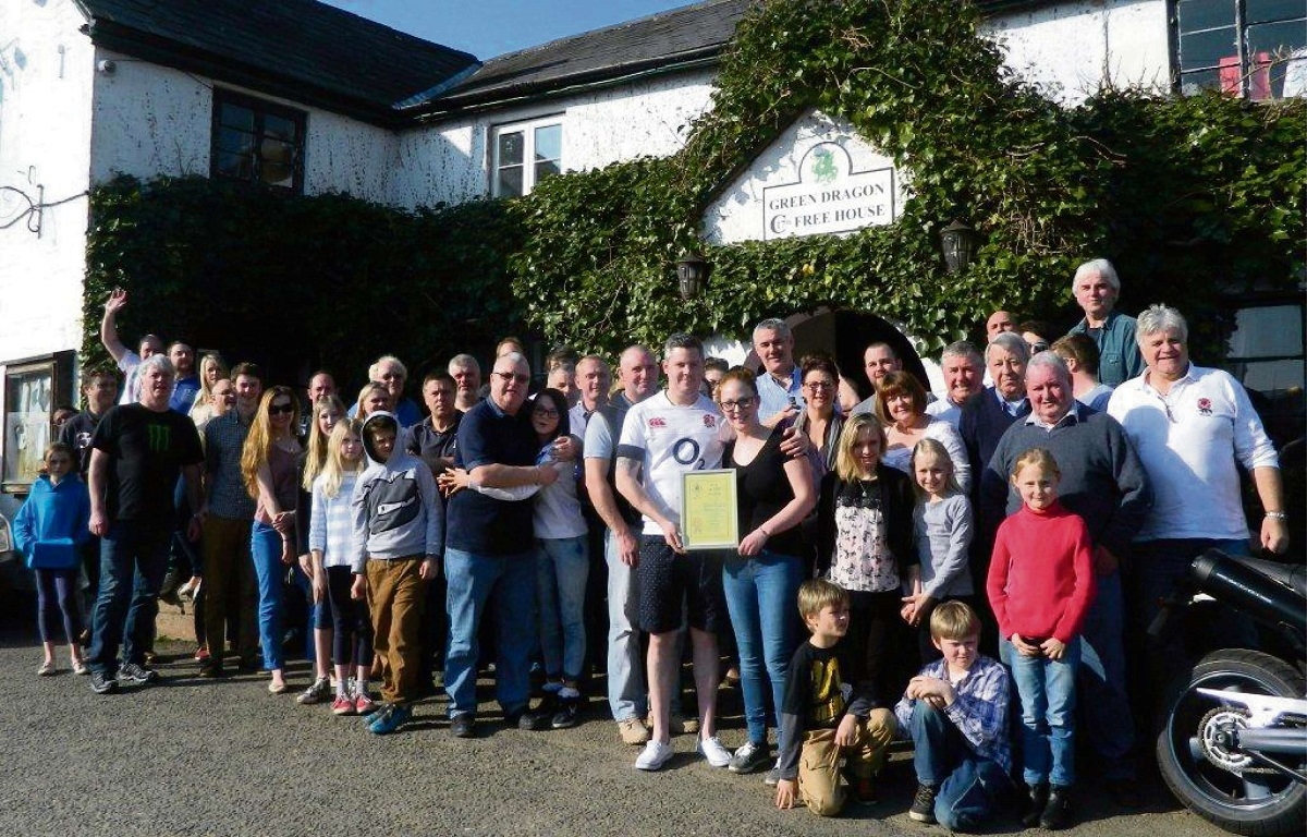 CHEERS! Regulars celebrate the Camra award for the Green Dragon Inn, Bishops Frome