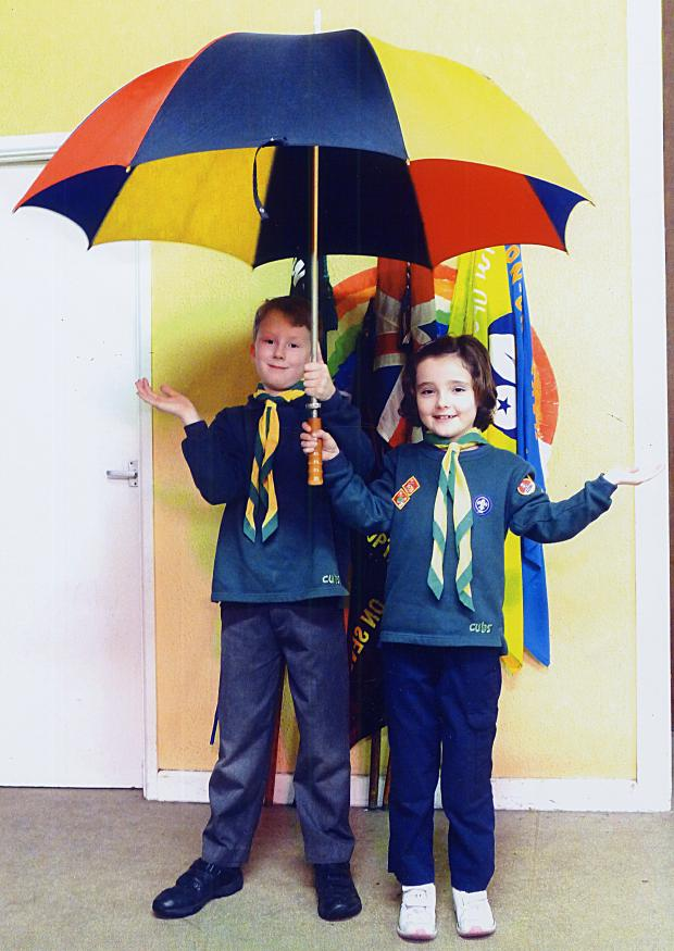 Malvern Gazette: Frankie Franks (left) and Lucy Tyrell of the Cub pack will be warm and dry again, thanks to the new roof.