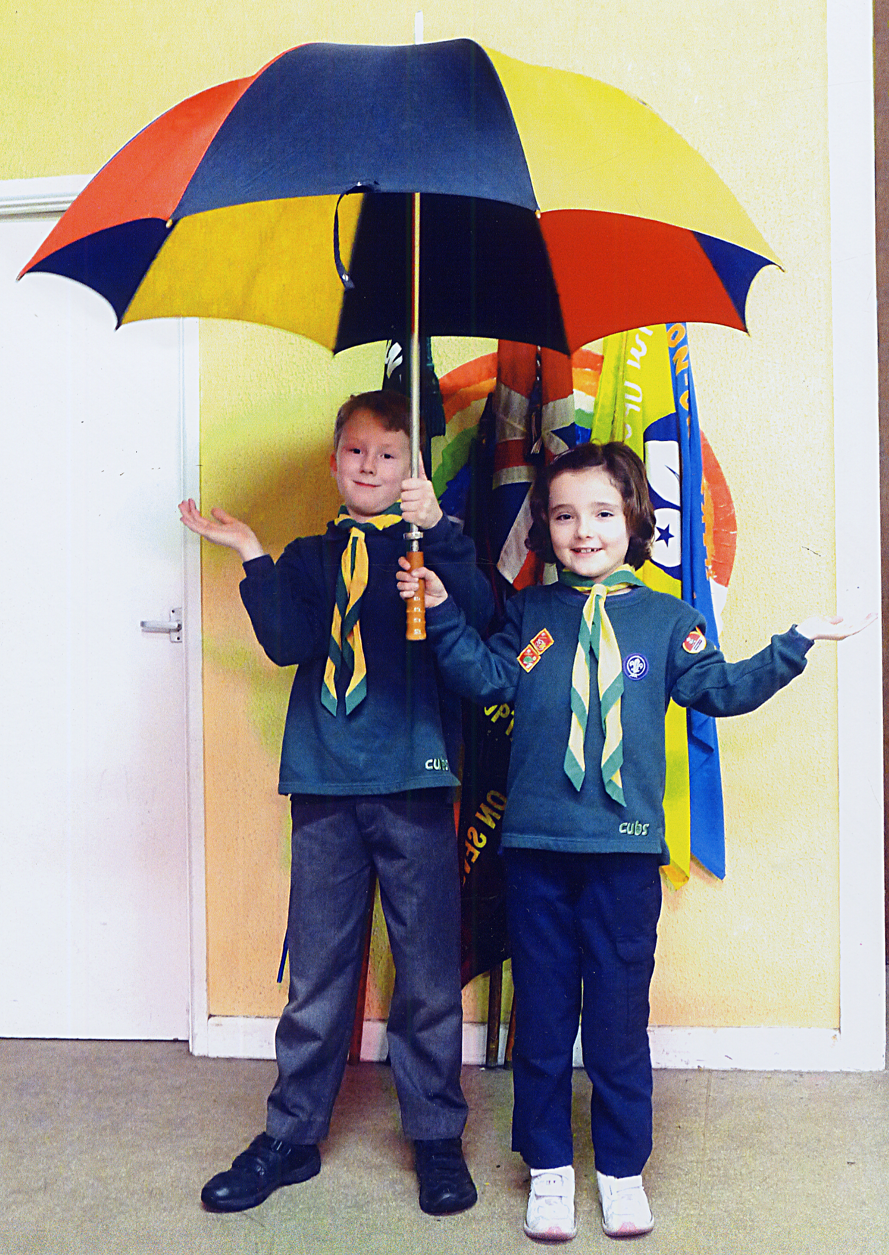 Frankie Franks (left) and Lucy Tyrell of the Cub pack will be warm and dry again, thanks to the new roof.