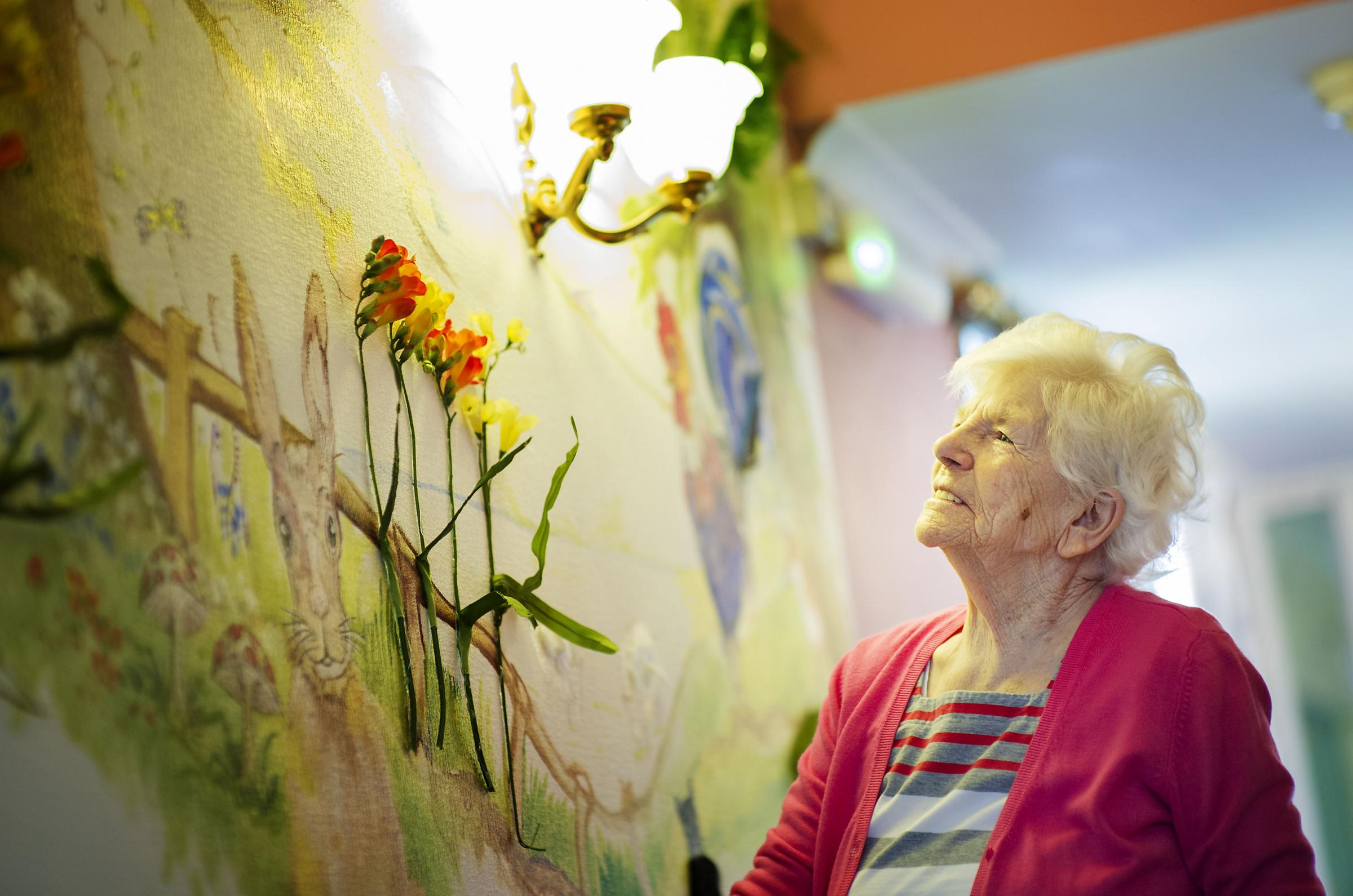 Peggy Gowrie, aged 95, of Beechwood Residential Care Home, Upton, examines the new sensory murals. Photo: Ed Maynard.