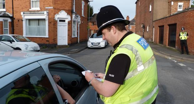 PC Mark Broughton talks to a driver at the junction of Britannia Square and Hebb Street