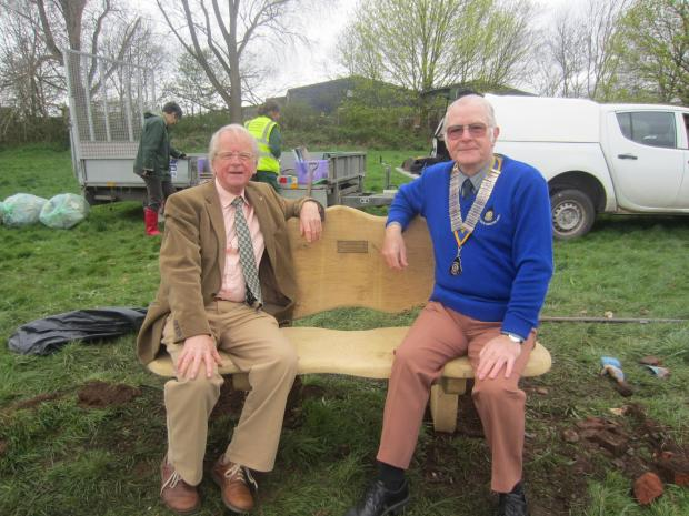 David Scott and Godfrey Benson of Worcester South Rotary Club test out the new bench.