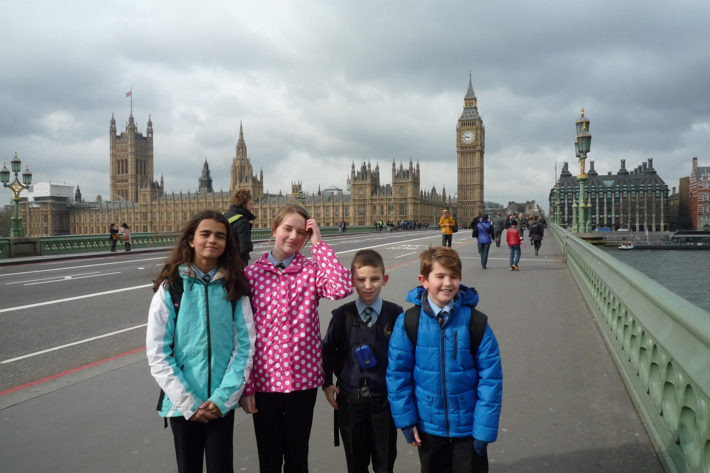 St Barnabas First and Middle School pupils Amara De Silva-Morgan, 12, Emma Galvin, 12, Ben Atkin, 11 and George Grech, 10, at the Houses of Parliament.