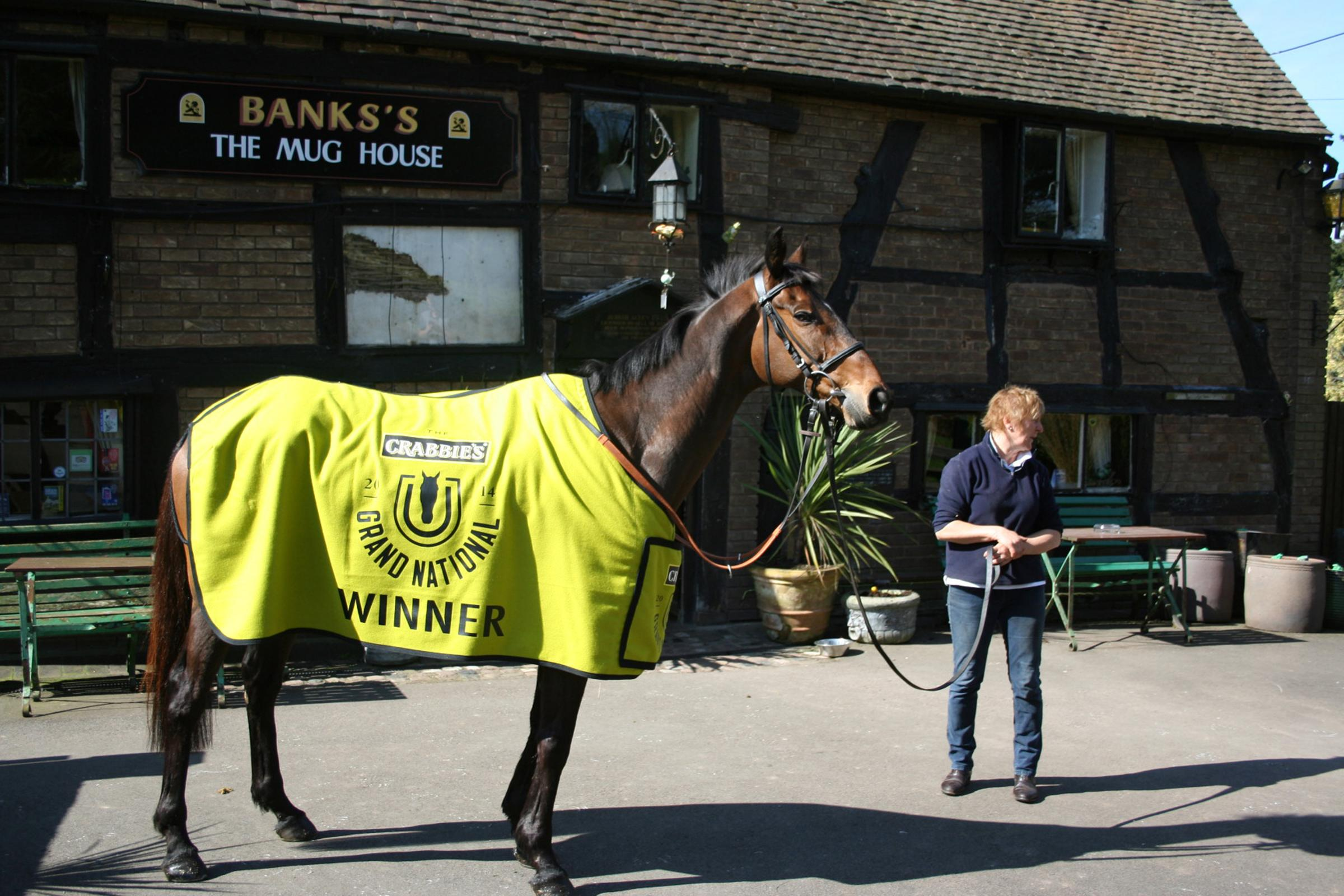 Forget the pinot grigio, it's Pineau De Re - Grand National winner outside The Mug House in Claines. Picture by Christopher Hughes (www.christopherhughesartist.co.uk)