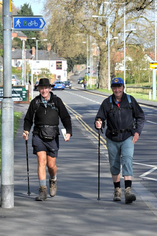 Malvern Gazette: Caminar..........Rob Steele (Right) stops off at the Worcester News, on his marathon walk to Spain,with Konrad Nofer from Bewdley Rotary Club, who was walking part of the Worcestershire leg of the walk. Pic Jonathan Barry 16.4.14 161457540 (5464296)