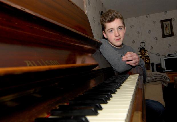 Malvern Gazette: 1714580402. 22/04/14. Kyle Hutchings aged 13 from Malvern. He has been awarded a scholarship with international concert pianist Richard Meyrick and is trying to raise funds to buy a new piano as his current one is old and unable to be retuned. Picture by