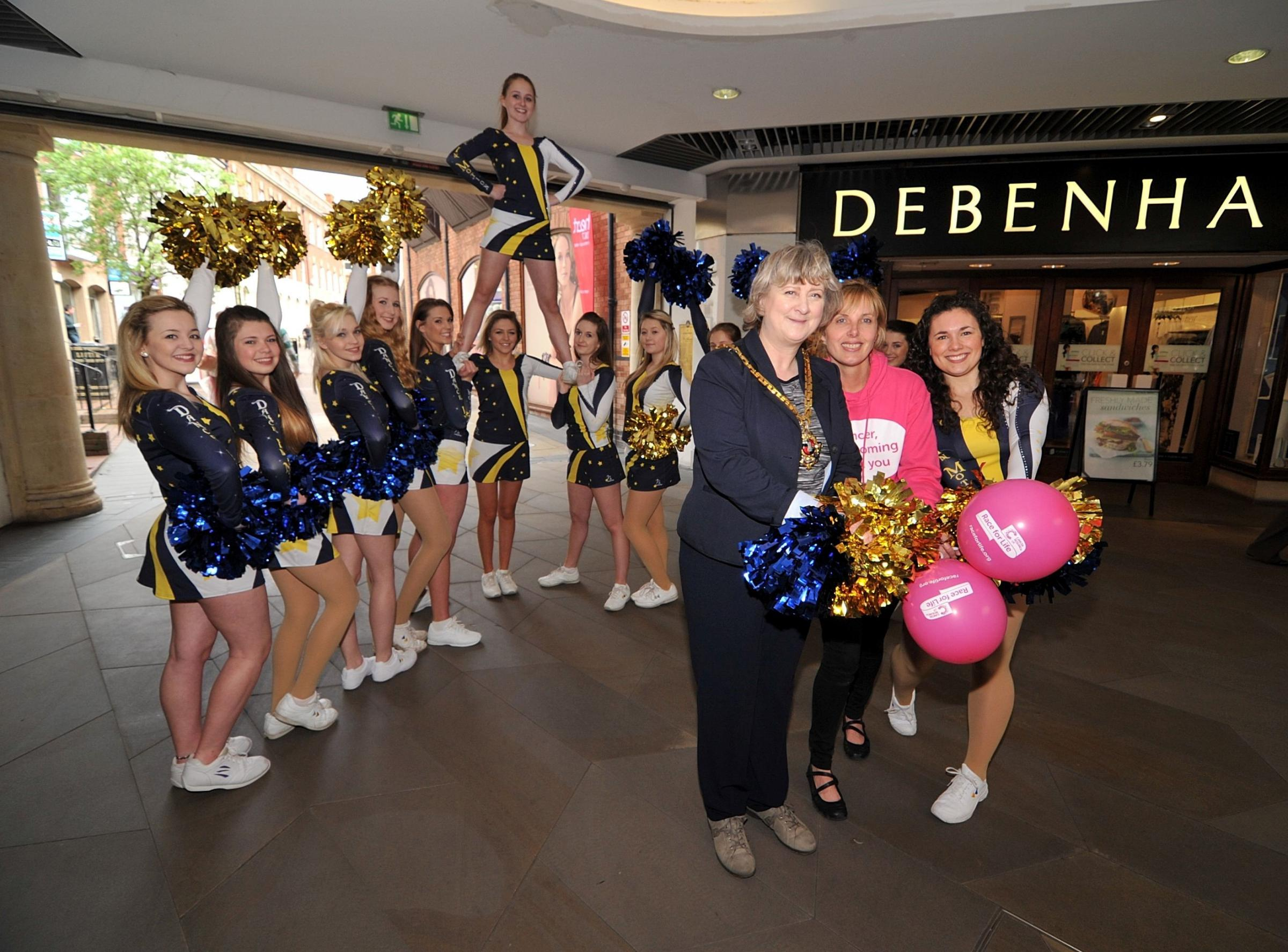 1714582601. 26/04/14. Mayor of Worcester Councillor Pat Agar, Cancer Research UK events manager Michelle Leighton and Gemma Hinton from Dance in Motion with the rest of the cheerleading team launch this