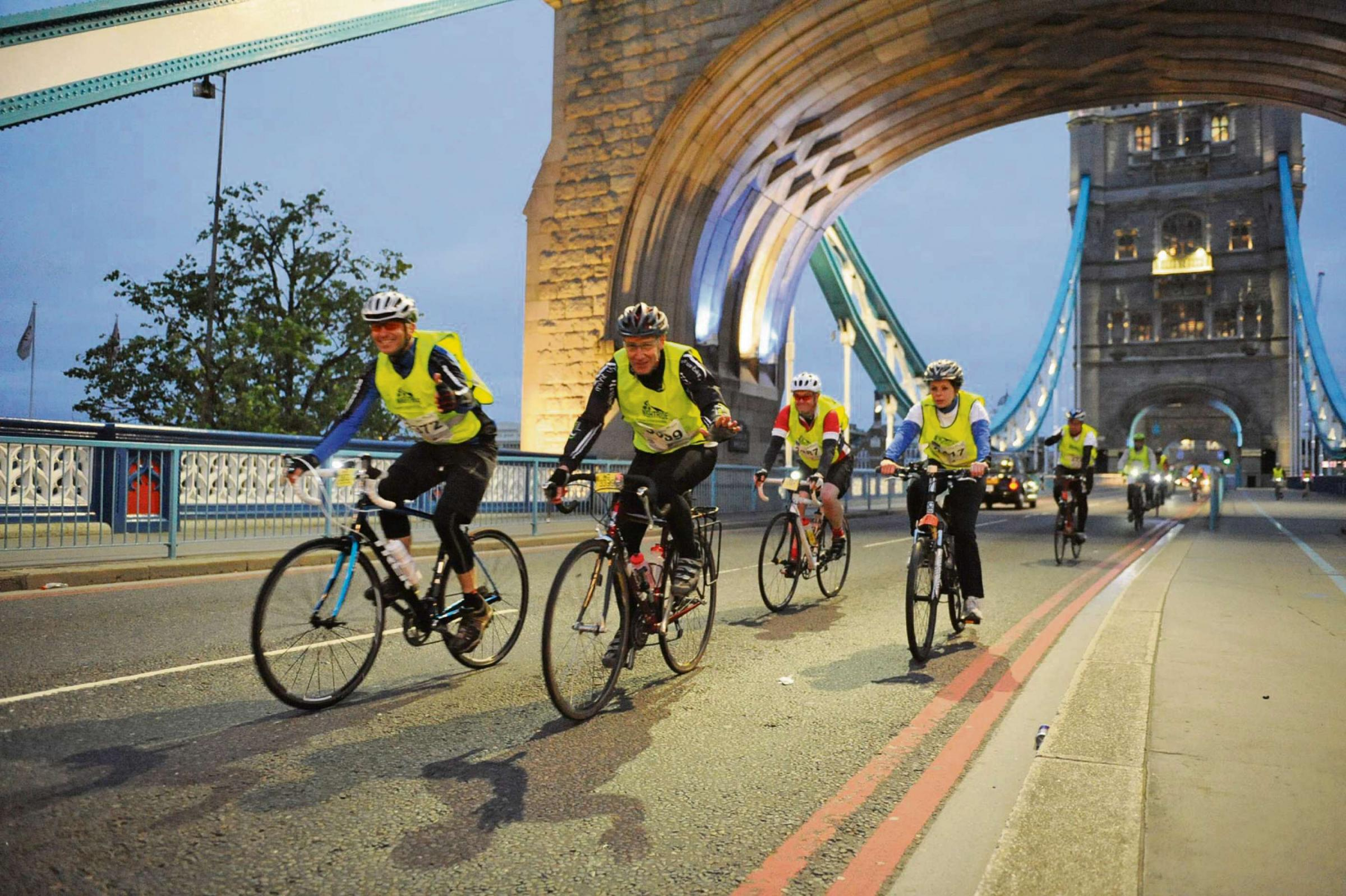 Cyclists taking part in last year's Nightrider on Tower Bridge.