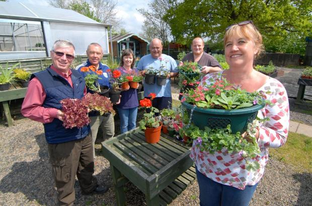 Malvern Gazette: STAFF at the Link Nurseries, Powick, are waiting to welcome visitors on Bank Holiday Monday. Left to right: horticultural therapist Roger Smith, Mike Shuck, Sarah Cance, Mark Rose, Tom Robinson and nursery manager Jane Smart. Picture by Nick Toogood. 1814