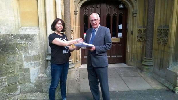 Malvern Gazette: Diane Pugh presents the Operation Badger petition to Councillor David Hughes.