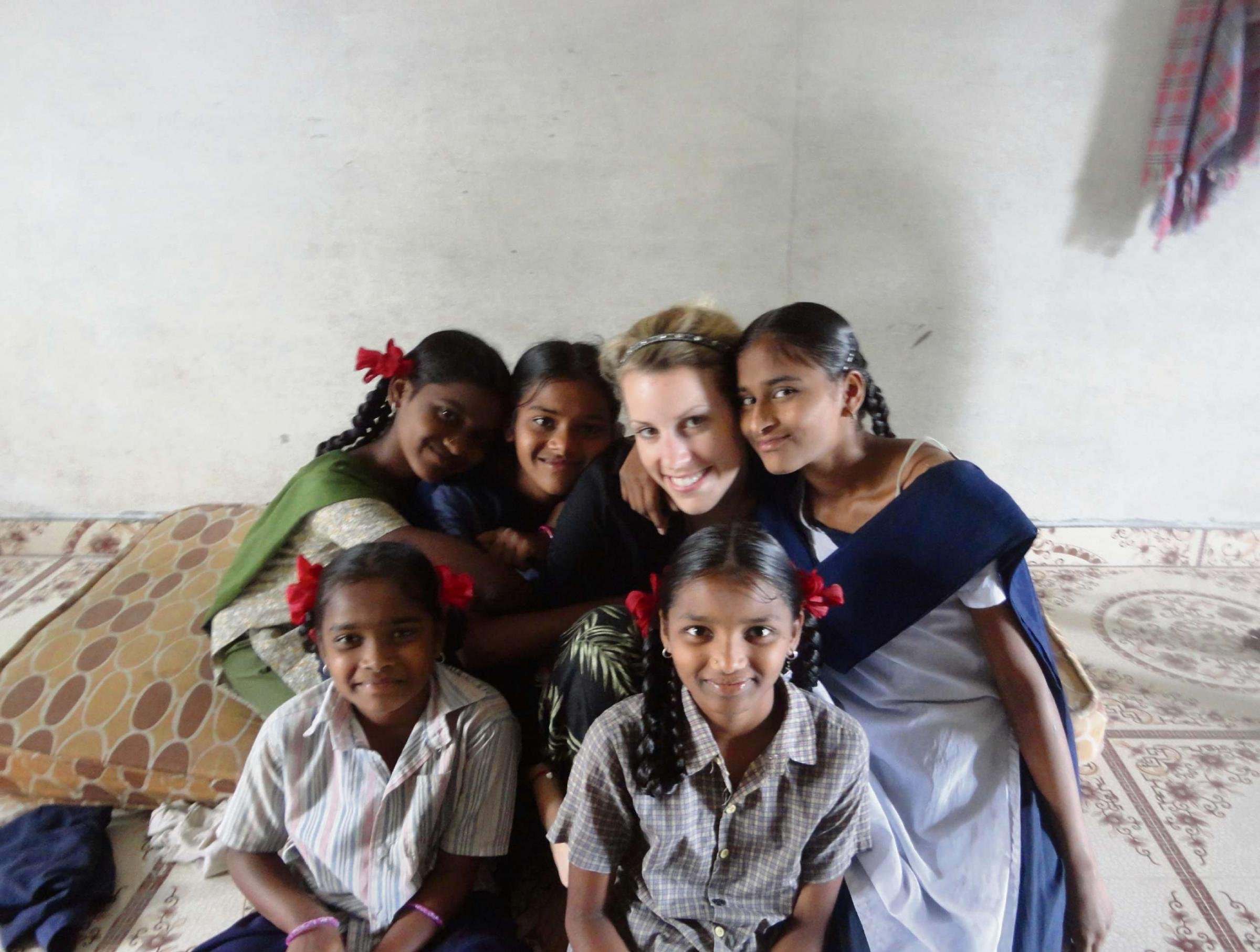 Lucy Miller with some of the children at the orphanage.
