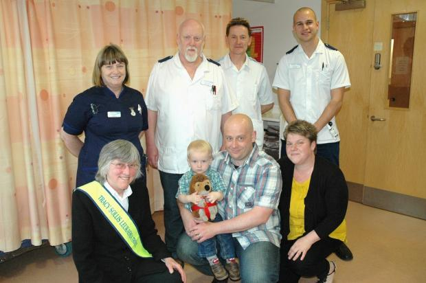 (Back L-R) Worcestershire Royal Hospital matron Glenis Adams, specialist nurse practitioner Pete James, care support worker Andy Wilce and clinical nurse specialist Tom Rees. (Front L-R) Sue Sollis with Antony Fessey, his son Oliver and wife Donna.