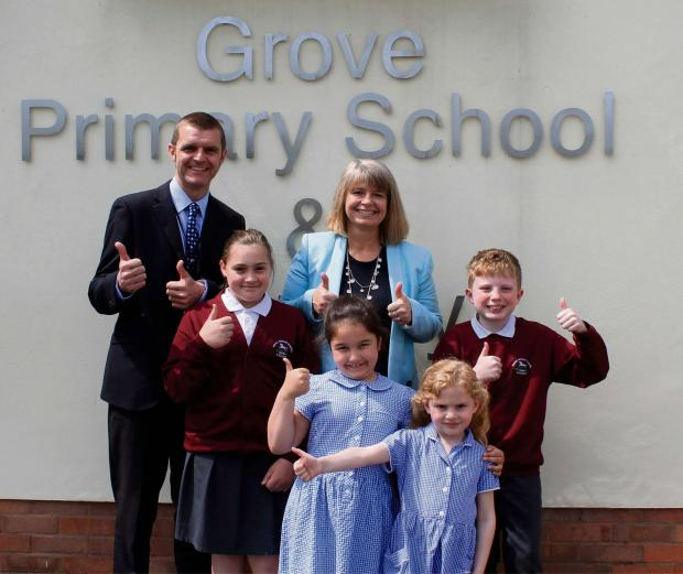 Pictured: Head Mark Ridlinton and Harriett Baldwin MP with )from left) Trinity Gray, aged 10, Sophie Taylor, seven, Poppy Etty-Leal, five, and Sean Merrick, 11.
