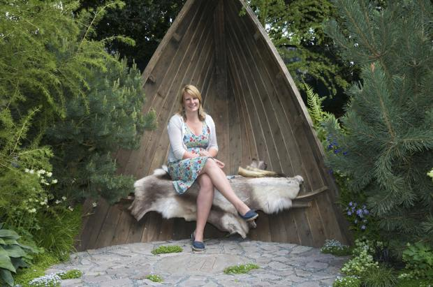 SITTING PRETTY: Sadie May Stowell in her award winning Chelsea Flower Show garden