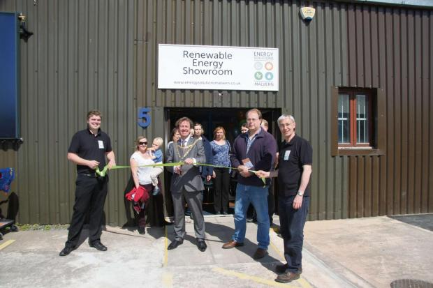Malvern's Mayor Councillor Julian Roskams cuts the ribbon to open the renewable energy showroom