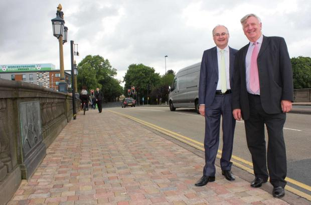 Malvern Gazette: Cllr Simon Geraghty, county councillor for the Worcester Riverside division, and cllr John Smith, cabinet member for Highways, on the improved Worcester Bridge where work on an improvement project was completed ahead of schedule overnight May 29/30.