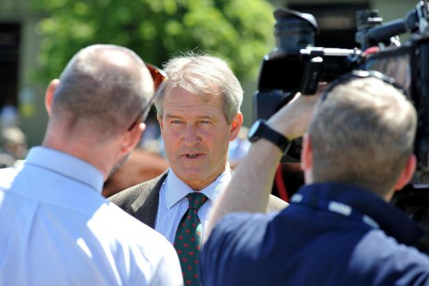 Malvern Gazette: 2414624214. 13/06/14. Royal Three Counties Show. Owen Paterson MP, Secretary of State for Environment, Food and Rural Affairs talks to a TV crew. Picture by Nick Toogood. (7142732)