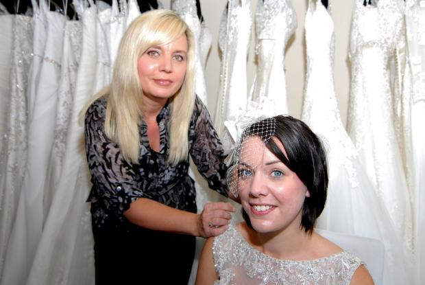 Malvern Gazette: Lauren Hirons, winner of a £1,000 wedding dress, has a tiara fitted by Suzanne Bacon-Lewis at Bridal Boutique, Lowesmoor. Picture by Nick Toogood 2114606704.