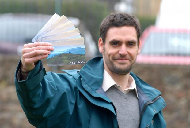 Malvern Hills Conservators conservation officer Jonathan Bills with the postcards on which people wrote their views on the hills' future. Picture by Nick Toogood. 1114541401.