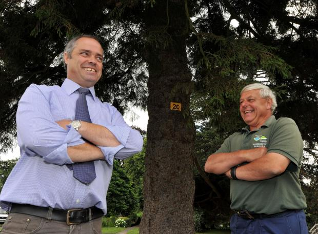 Malvern Gazette: Malvern Town Council operations manager Charles Porter and parks supervisor Tony Kiesslinger look at some of the trees in Priory Park that are marked for the Name the Tree competition for this year's Malvern in Bloom. Picture by John Anyon. 29