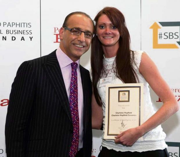 Artist Charlotte Hupfield receiving her award from Theo Paphitis.