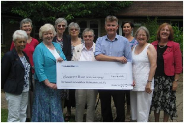 DONATION: Consultant Steven Thrush receives the money raised from events held during Worcestershire's WI's anniversary year (s)