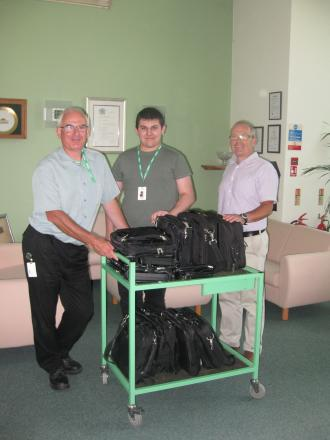 Pictured are Mark Herriott, development manager for Community First, (right), receiving the laptops from Martin Weaver (left) and Andrew Lewis (centre) of Malvern Instruments.