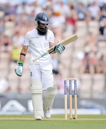 MOEEN ALI: Looks at his bat after being dismissed for 12 during day two of the Third Test between England and India at the Ageas Bowl, Southampton. England declared on 569-7.