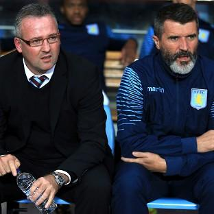 Paul Lambert, left, saw his side humbled by l