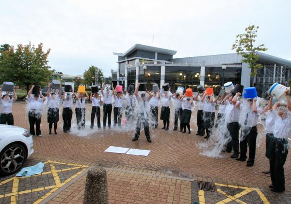 Ambulance service staff get soaked for charity