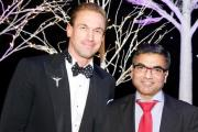 Tarun Sharma receiving his award from TV personality Dr Christian Jessen at the ceremony in Birmingham.