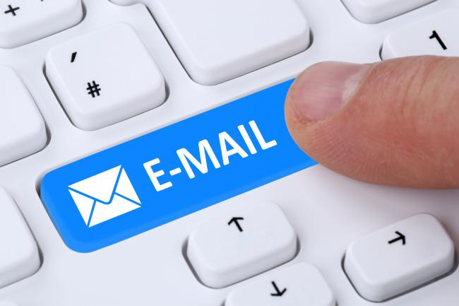 Sending E-Mail mail message by pushing button on computer keyboard with letter symbol (36487233)