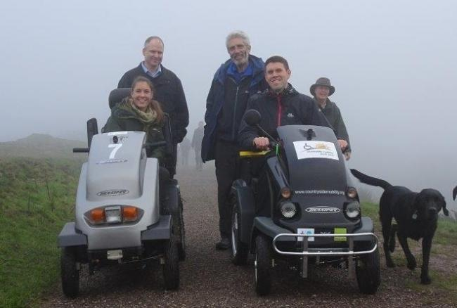 Back: Adrian Burden (Malvern Hills GeoCentre), John Cuthbertson (Disabled Ramblers), Beck Baker (Malvern Hills Conservators) and Neil Warren (Countryside Mobility, Living Options Devon) assess the Malvern Hills for disability scooter routes.