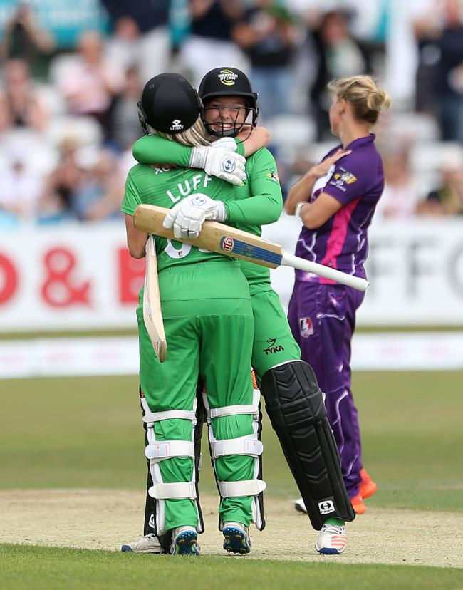 Malvern's Georgia Hennessy celebrates with Sophie Luff during her success with Western Storm. Picture: STEVE PASTON/PA WIRE