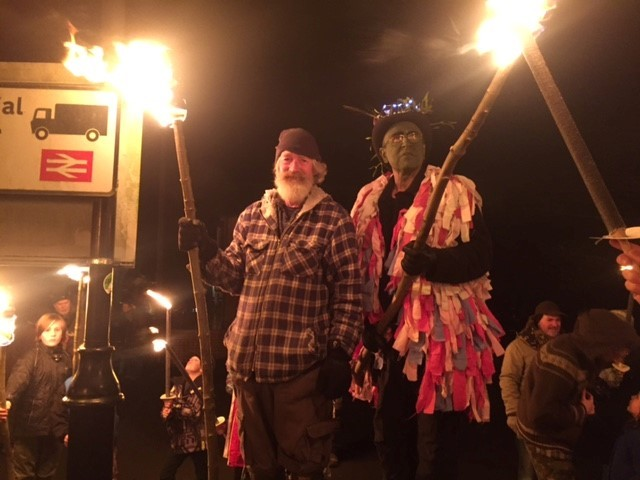 Wassailing in 2017: Tim Dixon and the Butler rally the crowd for torch lighting.