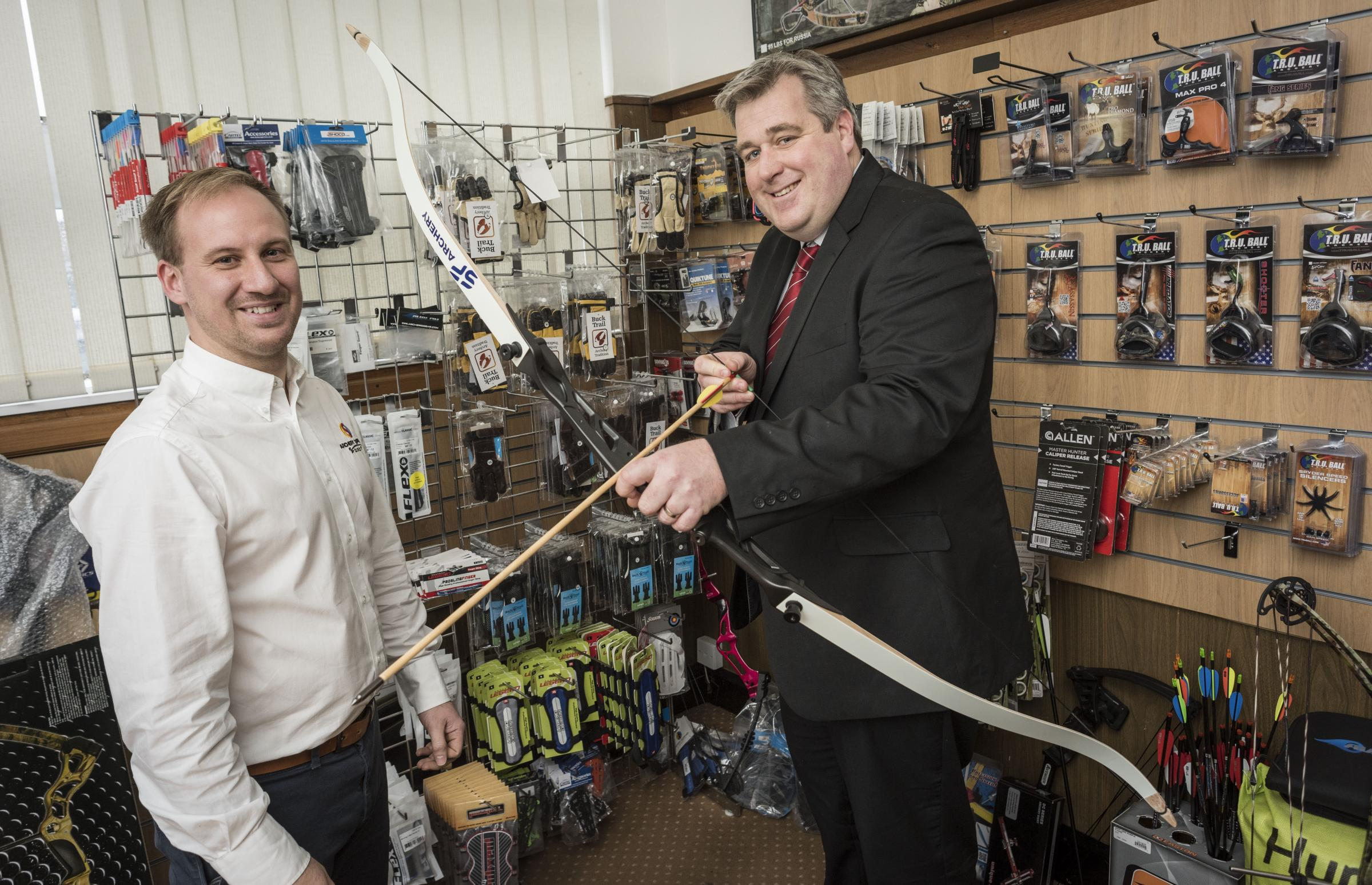 SHOP MOVE: Ian Parker is on target with helping Nathan Silcock from Archery Supplies Direct with their new premises.