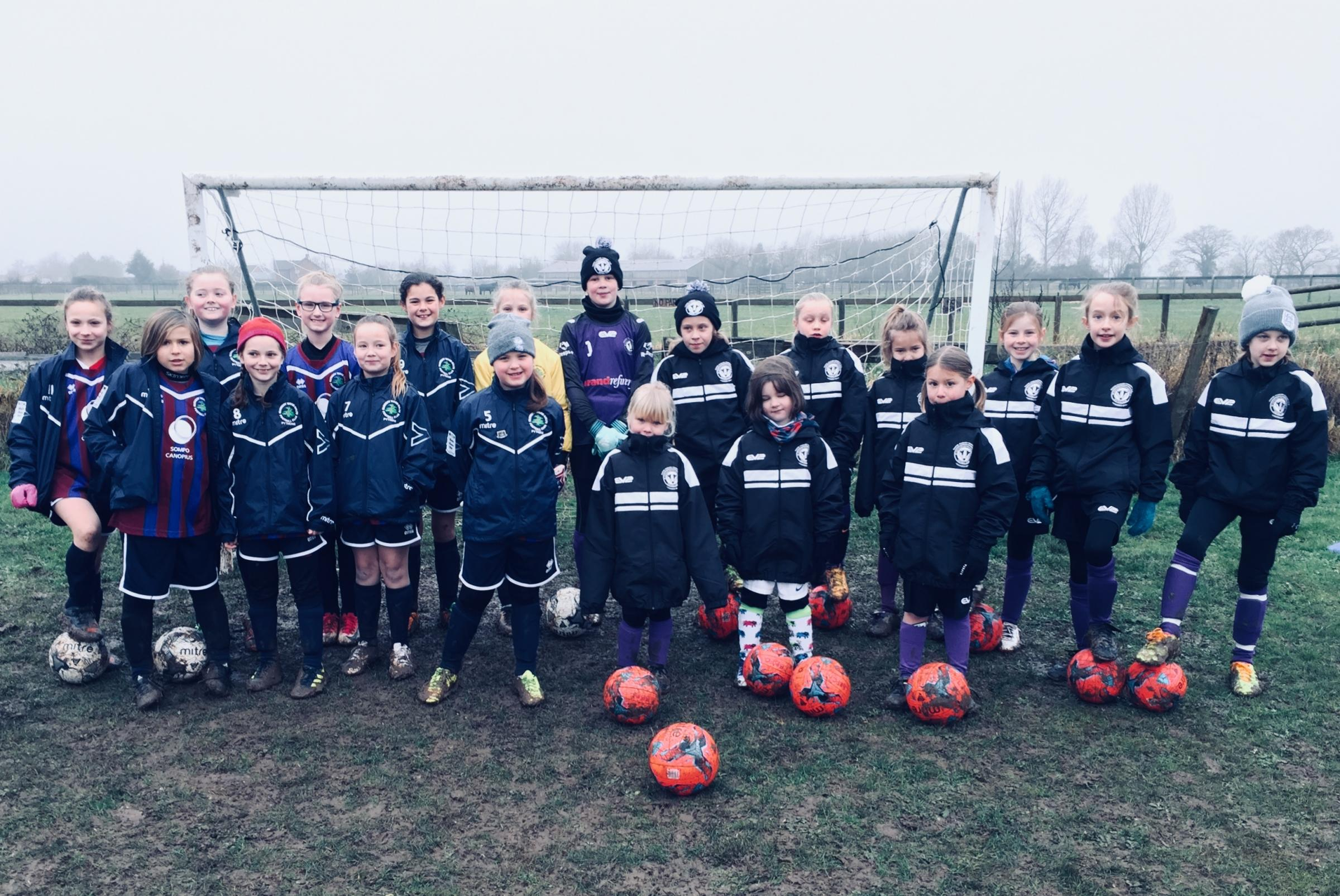 Under 10s girls footballers from Leigh and Bransford Badgers Belles and Nunnery Wood Pythons line up. Picture: SIMON SECRETAN