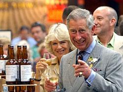 HRH The Prince of Wales and The Duchess Of Cornwall sample a glass from the Severn Cider Company