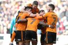 Benik Afobe is congratulated by his Wolves team-mates (Chris Radburn/PA)