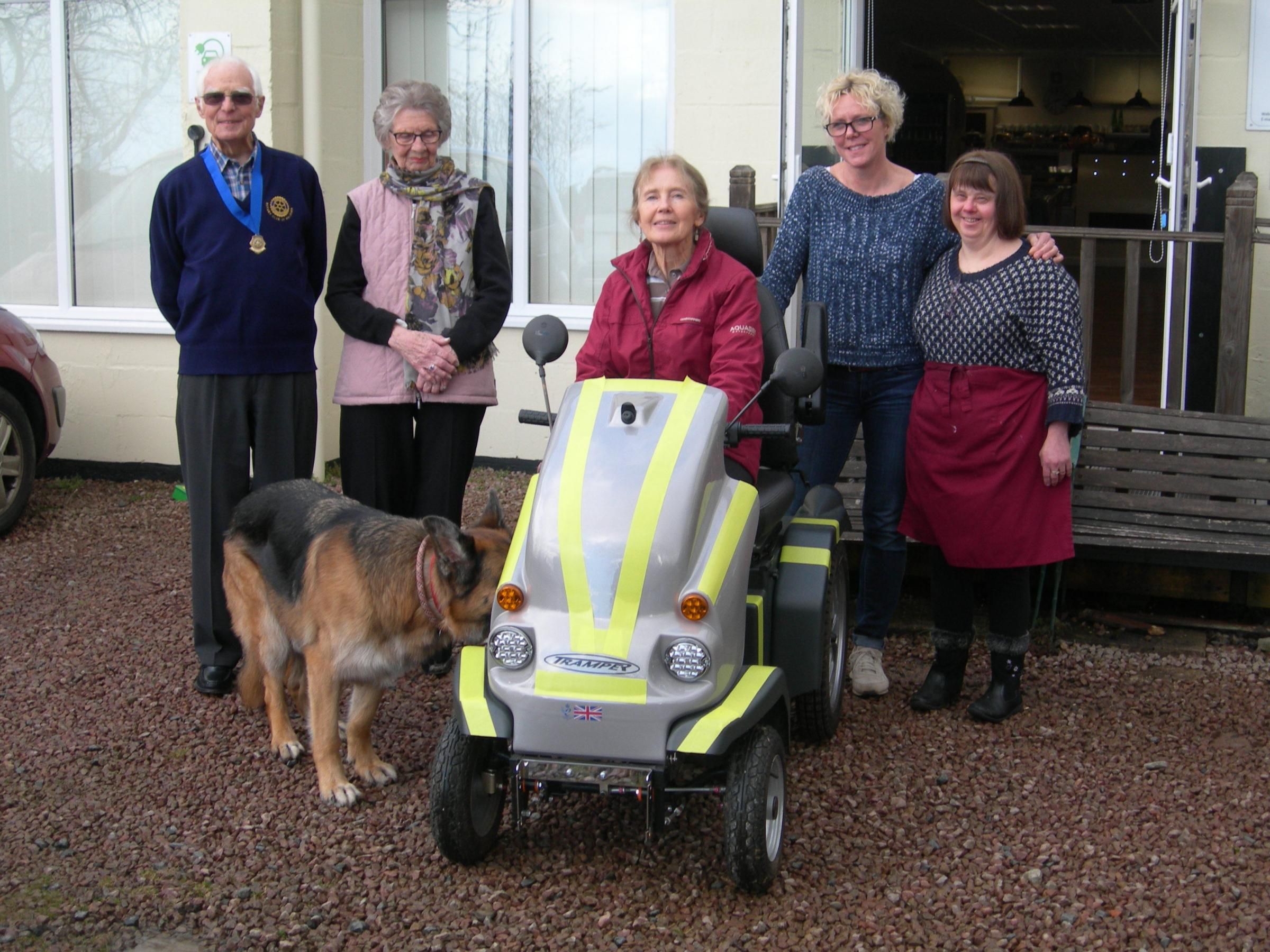 From left: Sandy Gibson,Shirley Abbott, Kate Harding and Alison Webb of Cafe H20 and Mrs Francis, plus Corky the Alsatian.