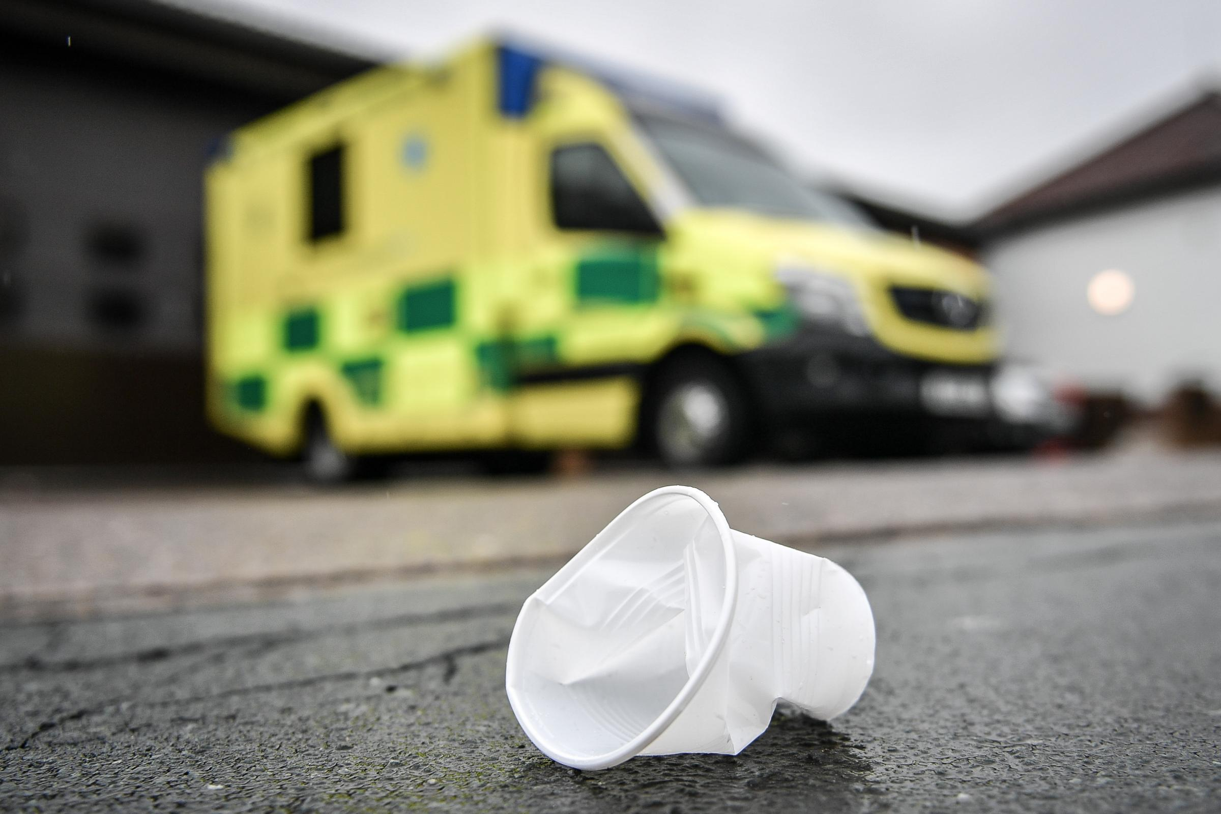 A used disposable drinking cup on the pavement by an ambulance station. While NHS trusts across the country opened up about the scale of disposable cup use, Government departments were less forthcoming. PRESS ASSOCIATION Photo. Picture date: Wednesday Apr