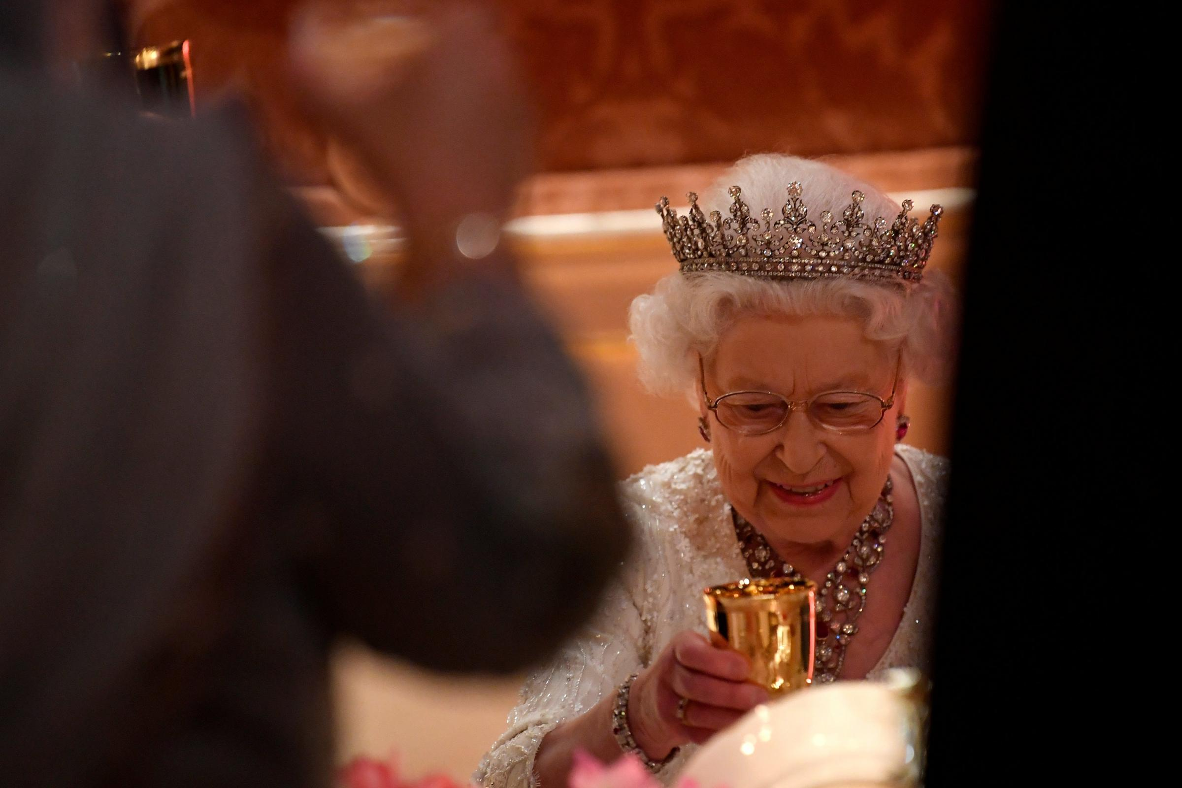 The Queen raises her glass for a toast (Toby Melville/PA)