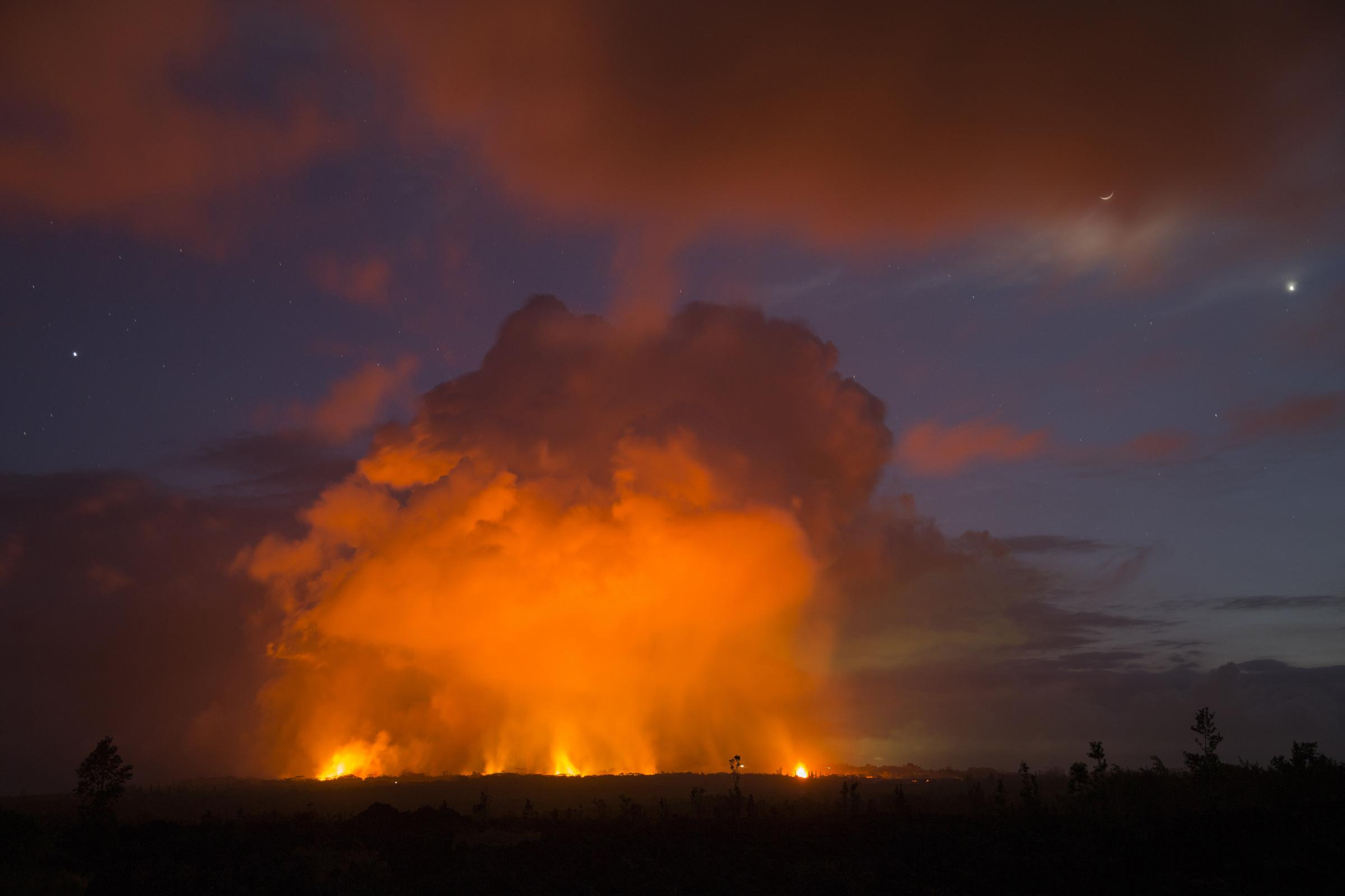 Volcanic activity from the Malama Ki and Leilani Estates neighbourhoods (AP Photo/Marco Garcia)