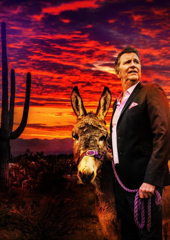 PENSIVE: And now the end is near? Stewart with a donkey, on his final, rather extensive tour.