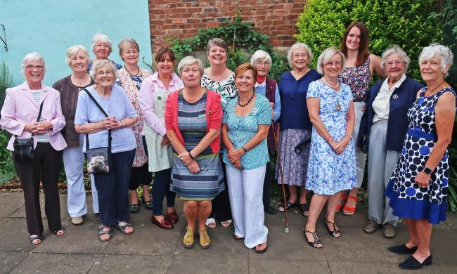 Sue Stone (four from right), Chairman of Worcestershire Federation of Women's Institute with past members of Upton WI